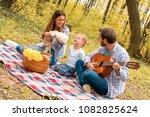 happy young couple enjoying... | Shutterstock . vector #1082825624