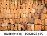 old orange brick wall pile... | Shutterstock . vector #1082828660