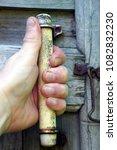 the hand holds the doorknob on...   Shutterstock . vector #1082832230