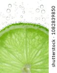 Lime Slice With Bubbles In...