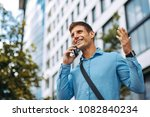 young businessman talking on... | Shutterstock . vector #1082840234