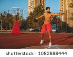 shirtless handsome man playing... | Shutterstock . vector #1082888444