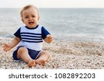 crying little boy on the sea... | Shutterstock . vector #1082892203