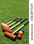 Small photo of Croquet mallets and balls lying on the lawn.