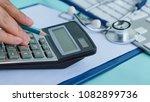 medical cost closeup calculates ... | Shutterstock . vector #1082899736