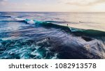 surfer ride on waves in ocean... | Shutterstock . vector #1082913578
