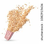 popcorn flies out of a paper cup | Shutterstock . vector #1082915636