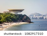 Small photo of NITEROI, BRAZIL - May 01, 2018: The Museum of Modern Art (MAC).Portuguese: Museu de Arte Moderna. Designed by brazilian architect Oscar Niemeyer with the Guanabara bay and in background Icaraí beach