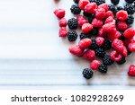 fresh berries on marble table ... | Shutterstock . vector #1082928269