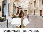 serious brunette fashionista... | Shutterstock . vector #1082928839
