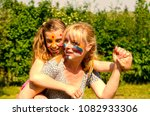 mother carry daughter with... | Shutterstock . vector #1082933306