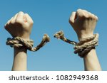 hands tearing shackles the... | Shutterstock . vector #1082949368