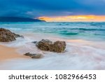 skies on fire at sunset  with... | Shutterstock . vector #1082966453