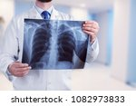 young male doctor examining x... | Shutterstock . vector #1082973833