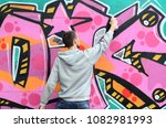 a young guy in a gray hoodie... | Shutterstock . vector #1082981993