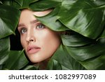 beauty woman face with green...   Shutterstock . vector #1082997089