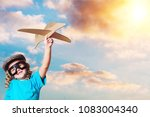 child plaing with airplane | Shutterstock . vector #1083004340