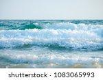 wave on the beach  sea foam in...   Shutterstock . vector #1083065993