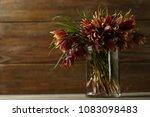 flowers bouquet on wooden boards | Shutterstock . vector #1083098483