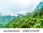 view on foggy death road in the ... | Shutterstock . vector #1083115439