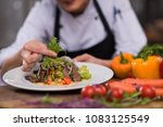 cook chef decorating garnishing ... | Shutterstock . vector #1083125549