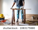people renovating the house... | Shutterstock . vector #1083175880