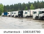 trucks in a row with containers ... | Shutterstock . vector #1083185780