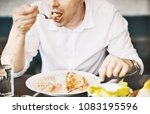 unrecognizable man eating lunch.... | Shutterstock . vector #1083195596