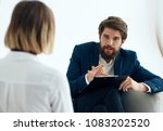 man with a folder  write down ... | Shutterstock . vector #1083202520