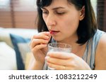 woman taking medication for her ... | Shutterstock . vector #1083212249