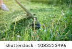 string trimmer at work ... | Shutterstock . vector #1083223496