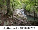 Stock photo waterfall at autumn forest selva de irati fall beech jungle in navarra pyrenees of spain cascade 1083232739