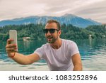 smiling man using smart phone... | Shutterstock . vector #1083252896