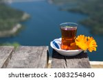 someone holds the tea in the... | Shutterstock . vector #1083254840