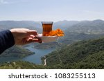 someone holds the tea in the... | Shutterstock . vector #1083255113