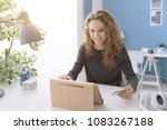 happy girl shopping online with ...   Shutterstock . vector #1083267188