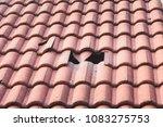 broken monier tiles roof  | Shutterstock . vector #1083275753