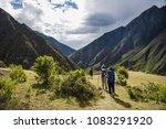 Tourists Hiking The Inca...
