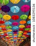 colored umbrellas hanging... | Shutterstock . vector #1083295136