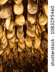 iberian cured hams stored in a... | Shutterstock . vector #1083295460