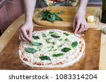 white pizza dough ready to bake ... | Shutterstock . vector #1083314204