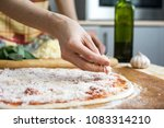 cook in the kitchen putting the ... | Shutterstock . vector #1083314210