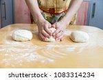 preparing pizza dough in a... | Shutterstock . vector #1083314234