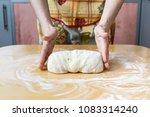 senior woman hands knead dough... | Shutterstock . vector #1083314240