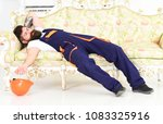 loader lay on sofa  having rest.... | Shutterstock . vector #1083325916