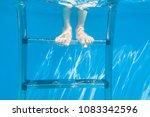 one pair of feet under water in ... | Shutterstock . vector #1083342596