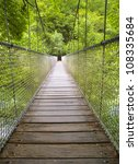 suspension bridge in the forest.... | Shutterstock . vector #108335684