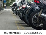 motorcycles parked in a row on... | Shutterstock . vector #1083365630