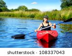 Girl With Paddle And Kayak On A ...