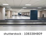 empty baggage conveyor belt at... | Shutterstock . vector #1083384809